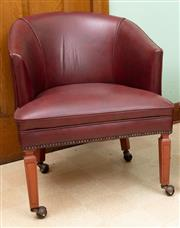 Sale 8795A - Lot 45 - A vintage burgundy leather tub chair C: 1960. The piped leather back and seat raised on tapering front legs and shepherd castors. Ht...