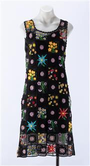 Sale 8910F - Lot 69 - A Moschino Cheap and Chic lace and croched sleeveless shift dress with slip, marked GB 14