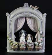 Sale 8989 - Lot 89 - Lladro Please come home figural group of dogs framed with flowers (H22cm) 6502