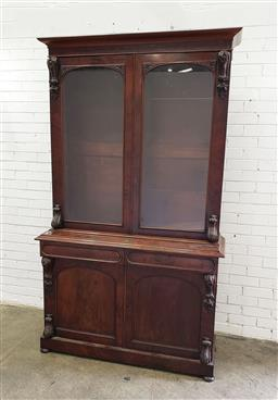 Sale 9085 - Lot 1010 - Good Victorian Mahogany Bookcase, with two arched glass panel doors flanked by corbels, above two oval panel drawers & two further t...