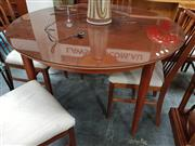 Sale 8684 - Lot 1068 - Teak Round Extension Dining Table with Cross Band