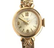 Sale 8534 - Lot 335 - AN 18CT GOLD LADYS WRISTWATCH; round dial signed Tyson on a 17 jewell movement, fancy lugs, 18ct band with later handmade extension...