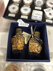 Sale 8819 - Lot 2350 - Set of Faux Gilt Coins and Two bottles of Gold Foil