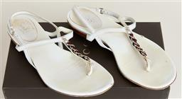 Sale 9092F - Lot 74 - A PAIR OF GUCCI CREAM SANDALS; with chain mid section, in original box, size 38C,  some stains