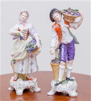 Sale 8430 - Lot 91 - A pair of German porcelain figures of Vintners. Height 23cm.