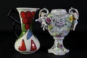 Sale 8994 - Lot 69 - A Crown Devon handpainted jug by Dorothy Anne (H22.5cm) together with a porcelain handpainted urn (no lid, H22cm)