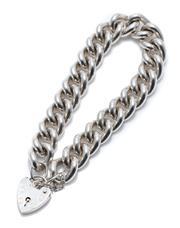 Sale 9012 - Lot 384 - A HEAVY STERLING SILVER PADLOCK BRACELET; 11.7mm wide curb links to an heart shape padlock clasp hallmarked ASJ London 1990, with sa...