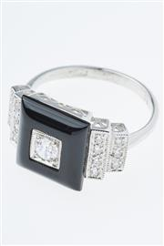 Sale 8293 - Lot 343 - A DECO STYLE SILVER AND STONE SET RING; set with an onyx plaque and cubic zirconias, size M-N.