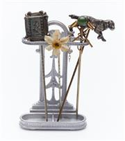 Sale 9080W - Lot 51 - A miniature metal hallstand containing four stick pins, themed for croquet, hunting, daffodil and a frame.