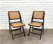 Sale 9092 - Lot 1083 - Pair of vintage folding timber chairs with rattan seat and back (h83 x w 42 x d50 -