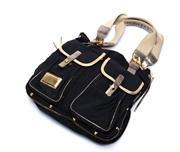 Sale 8760F - Lot 21 - A Marc by Marc Jacobs black canvas twin pocket army messenger tote with gold-tone trim and hardware, H 34 x W 36cm