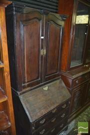 Sale 8345 - Lot 1062 - Georgian Assembled Oak Bureau Bookcase, the upper section with two timber panel doors enclosing shelves & pigeon holes, above a fall...