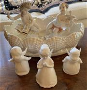 Sale 8510A - Lot 49 - A shell form lustre bowl with two Bavarian musical cherubs and three bisque/ bone china kissing cherubs, the tallest H 17cm