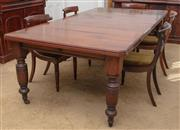 Sale 9058H - Lot 30 - A Federation oak extension dining table on turned baluster legs to castors with winder, Height 78cm x Length fully extended 242cm x...