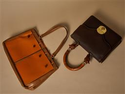 Sale 9093F - Lot 91 - Anya Hindmarch x 2 vintage brown leather bags one with wooden carved dog feature on the handles.