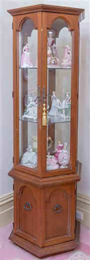 Sale 8430 - Lot 94 - A hexagonal display cabinet with two arched glass panel doors and two timber doors below. Height 191 x 70cm.