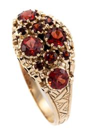 Sale 8899 - Lot 357 - A VICTORIAN STYLE GARNET RING; set in 9ct gold with round cut spessartite garnets on engraved band, size O.