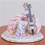 Sale 8430 - Lot 98 - An Italian pottery figure of a cello player (missing bow).