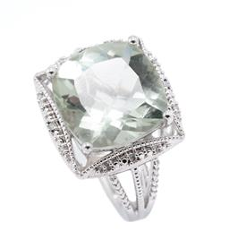 Sale 9246J - Lot 340 - A SILVER GREEN AMETHYST AND DIAMOND COCKTAIL RING; featuring a cushion cut green amethyst of approx. 10.34ct to surround of 16 singl...