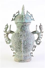 Sale 8994 - Lot 34 - A Chinese Bronze wine vessel and cover, body decorated with archaic mask motifs (H35cm)