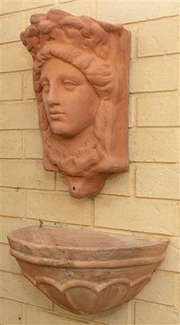 Sale 9120H - Lot 5 - A two piece terracotta water fountain of classical female head design, bowl Width 41cm