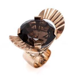 Sale 9213 - Lot 342 - A LARGE VINTAGE 9CT GOLD SMOKY QUARTZ COCKTAIL RING; featuring an approx. 88ct round cut smoky quartz (loose in setting) adjacent on...