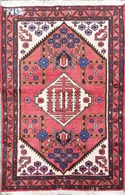 Sale 8714 - Lot 1045 - Small Possibly Hamadan Wool Carpet, with cream medallion & floral clusters on a red field (146 x 100cm)