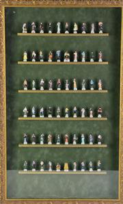 Sale 8902 - Lot 51 - A set of Vietnamese figurines in frame (45cm x 73cm)