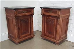 Sale 9196 - Lot 1035 - Pair of Early 20th Century Walnut Bedside Cabinets, with black marble tops, each having a drawer & carved panel door (h82 x w58 x d4...