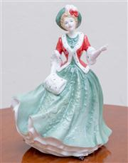 Sale 8430 - Lot 101 - A Royal Doulton Figure, Christmas Day 2000 HN 4242. Height 22cm.