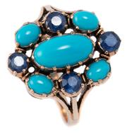 Sale 9046 - Lot 340 - A 9CT GOLD SAPPHIRE AND TURQUOISE RING; oval cluster set with 5 cabochon turquoise and 4 round cut blue sapphires, size O, top 18 x...