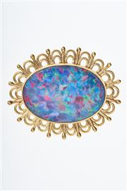 Sale 8293 - Lot 335 - AN 18CT GOLD OPAL BROOCH; featuring a 30 x 22mm fine black opal doublet set in a decorative frame, wt. 12.7g.