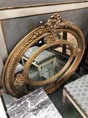 Sale 8822 - Lot 1838 - Ornate Oval Gilt Framed Mirror - 216 (H: 115 W: 125cm)