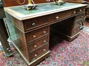 Sale 8576 - Lot 1038 - Victorian Oak Double Pedestal Desk, with tooled green leather top & nine drawers with timber knobs. Spare Knobs in office.(73 x 135 x 7