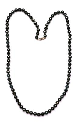 Sale 9144 - Lot 68 - A Black Pearl necklace with silver clasp