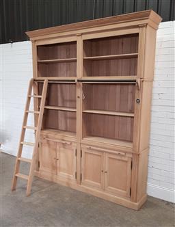 Sale 9191 - Lot 1015 - Large pine bookcase with ladder (h:241 x w:198 x d:46cm)