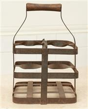 Sale 8902H - Lot 62 - A vintage French four-bottle carrier in wrought iron, approx. 32 cm tall