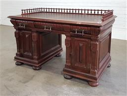 Sale 9196 - Lot 1060 - Late 19th Century French Renaissance Revival Oak Desk, with spindle gallery back & tooled brown leather top, above three frieze draw...