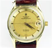 Sale 8402W - Lot 42 - UNIVERSAL POULEROUTER DATE AUTOMATIC WRISTWATCH; golden dial with engine turned hour markers, centre seconds, date on a 28 jewell ca...