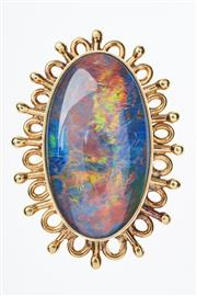 Sale 8293 - Lot 328 - AN 18CT GOLD OPAL RING; set with a 27 x 16mm fine black opal triplet in a decorative surround, size P, wt. 14.4g.