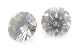 Sale 9169 - Lot 331 - A PAIR OF UNSET ROUND BRILLIANT CUT DIAMONDS; 0.20ct (chipped), 3.73 X 2.22mm and 0.21ct, 3.66 x 2.40mm, both gray, P1