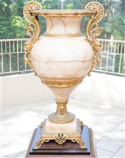 Sale 8341A - Lot 90 - An early C20th French Onyx and gilt metal urn with lion mask handles, H 78 x W 50cm