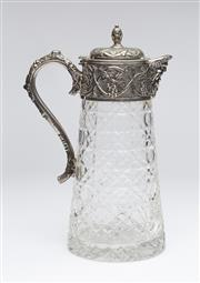 Sale 8651A - Lot 91 - A large hand cut lead crystal and plate wine ewer. The mount decorated with a bacchanalian mask  head spout with trailing grapes and...