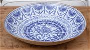 Sale 9023H - Lot 24 - Charlotte Gaborit, LÉnvol - A Fine porcelain blue and white bowl hand made of irregular form Dia. 35cm