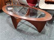 Sale 8782 - Lot 1097 - Oval G Plan Teak Atmos Coffee Table with Glass Top