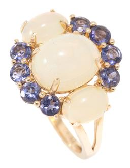 Sale 9160 - Lot 309 - AN OPAL AND GEMSTONE RING; set in silver gilt with 2 oval cabochon ethiopian opals and 8 round cut tanzanites, size N1/2, top 16mm w...