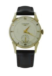 Sale 8406A - Lot 32 - Fine early Longines 14 K solid gold manual wind wristwatch, circa 1950s, 30mm, fully restored