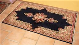 Sale 9120H - Lot 20 - A hand knotted kirman carpet with central medallion on a blue ground, 88cm x 158cm