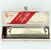Sale 8390A - Lot 42 - Larry Adler Professional Harmonica by M. Hohner