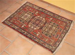 Sale 9120H - Lot 21 - A hand woven Persian tribal wool carpet with zoomorphic and geometric pattern on red ground, 102cm x 75cm (worn)